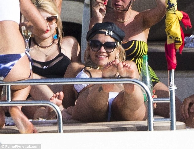 Good spirits: Rita certainly looked happy and relaxed as she spent time with her close friends in Ibiza