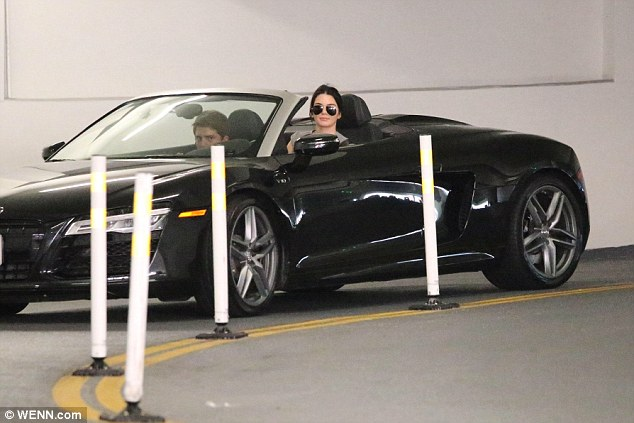 Sunny LA weather: Kendall sported aviator sunglasses as she put the top down in her swanky Audi car