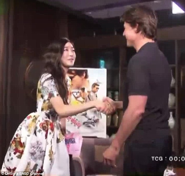 Giving her a shake: The prominent Scientologist was delighted to meet K-pop star Tiffany