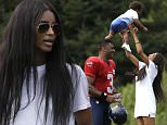 Seattle Seahawks quarterback Russell Wilson (3) looks on as his girlfriend, entertainer Ciara Harris, playfully tosses her son, Future, 14 months, in the air after an NFL football training camp Monday, Aug. 3, 2015, in Renton, Wash. (AP Photo/Elaine Thompson)