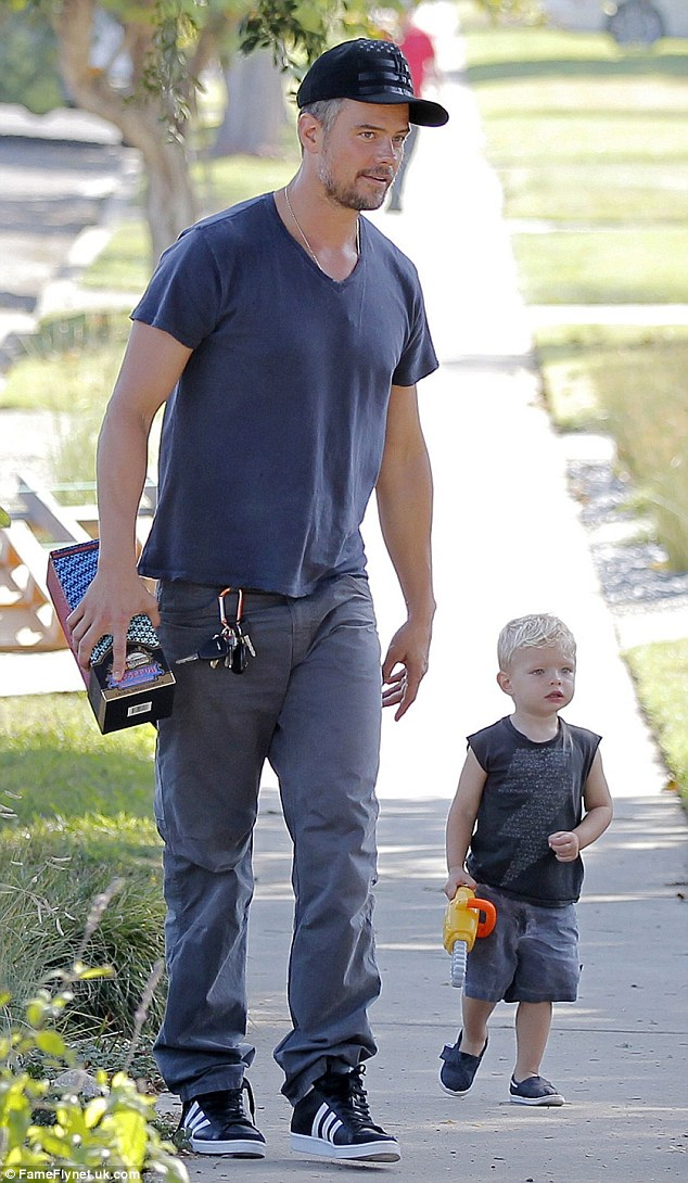Bonding time: Josh Duhamel and his son Axl looked like two peas in a pod while walking together to a friend's birthday party in Brentwood on Sunday