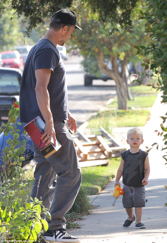 Hey you!The 42-year-old actor was dapper while waiting for his son to catch up, having paired a navy blue tee and grey cargo pants with shiny new Adidas sneakers