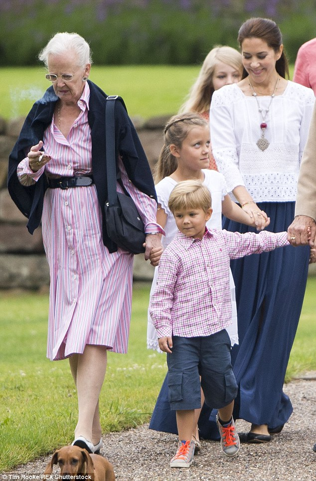 Crown Princess Mary appeared undisturbed by the Queen's proximity to her children while puffing away