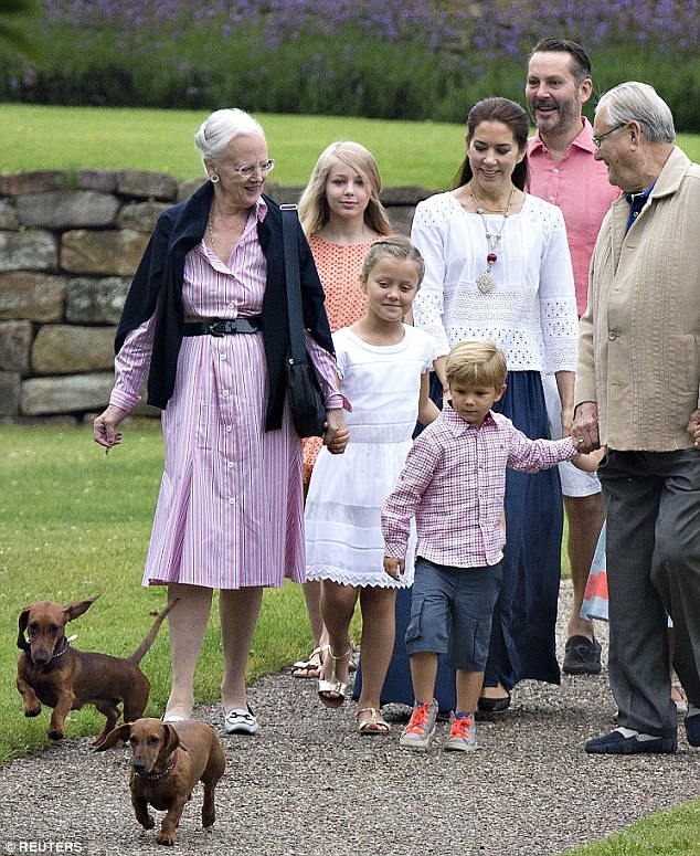 Too close for comfort? Denmark's Queen Margrethe was pictured smoking a cigarette while walking with her grandchildren last week