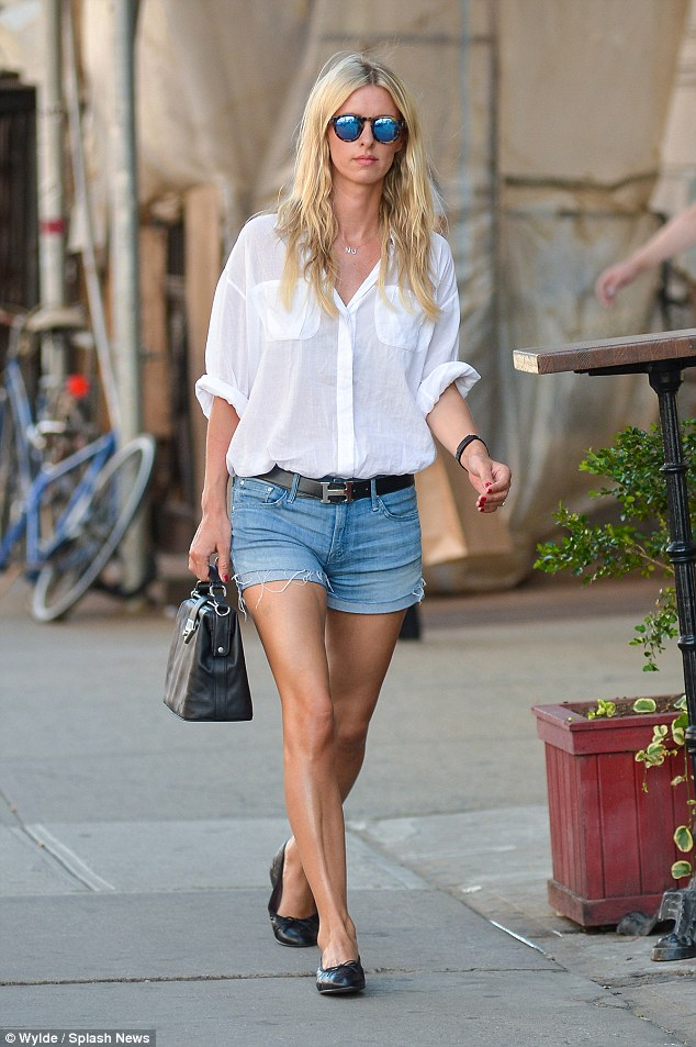 Simple but stylish: The 31-year-old's legs looked perfect in the tiny denim Daisy Dukes which she teamed with a loose white shirt and black accessories