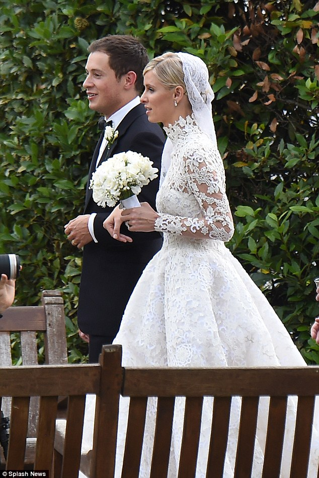 Stunning scenes: Nicky tied the knot with banking heir James in an opulent wedding at Kensington Palace in London on July 10