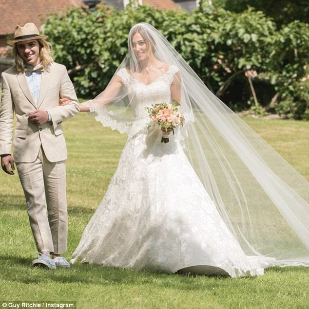 Key role: Guy's son Rocco looked dashing in his suit and bow tie as he walked with Jacqui
