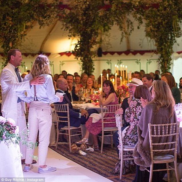 Best man duties: Guy shared a photo of his eldest giving what looked like a rousing speech at the reception