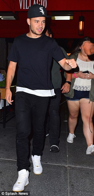 Paparazzi pals: Liam, 21, seemed in a relaxed mood as he fist-bumped one pap