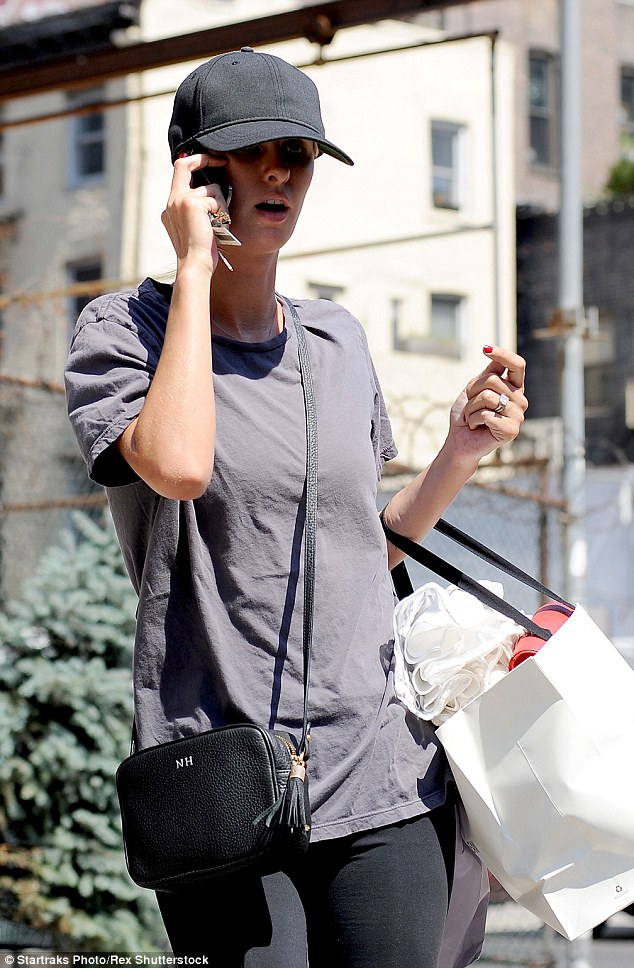 Toned: She covered her slim frame with a faded black short-sleeved t-shirt, as she chatted animatedly on her phone