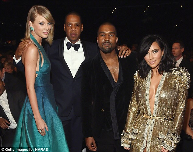 Peacemaker: Taylor (left) says it was down to Jay Z (centre left) that she healed a rift with Kanye (centre right) - pictured with Kim Kardashian (right) at the 57th Annual GRAMMY Awards on February 8, 2015