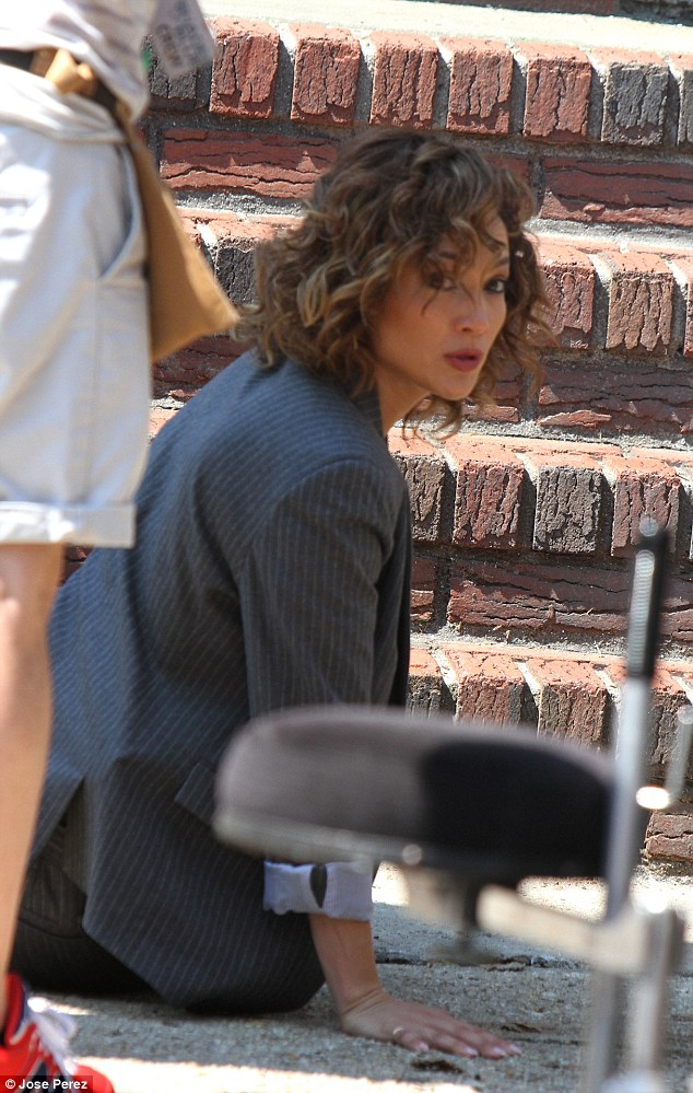 How's that? Jennifer looked over her shoulder as though waiting for the director's cue