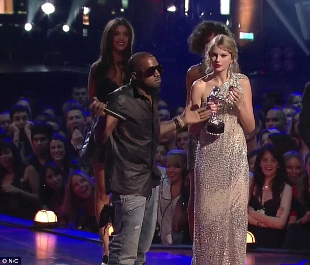 Awkward: The two have healed the row which came to a head when Kanye infamously interrupted her acceptance speech for Best Female Video at the 2009 MTV Video Music Awards (pictured) to insist Beyonce should have won the accolade