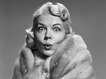 01 Dec 1950 --- 1950s woman wrapped in fur stole making funny facial expression looking at camera --- Image by © ClassicStock/Corbis