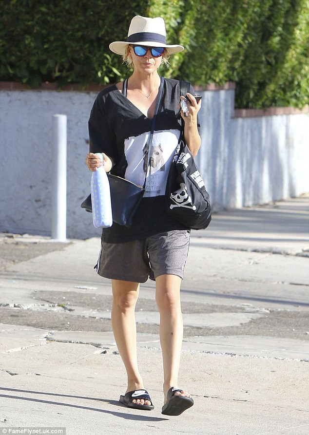 Baggy:Kaley wore an oversized T-shirt bearing the image of a dog and wide-legged gym shorts which drowned the stars trim figure
