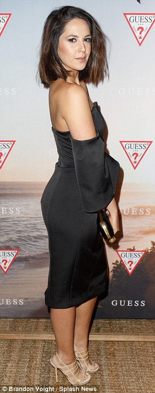 A leggy display: Radio host Zoe Marshall opted for a neautral black evening dress...