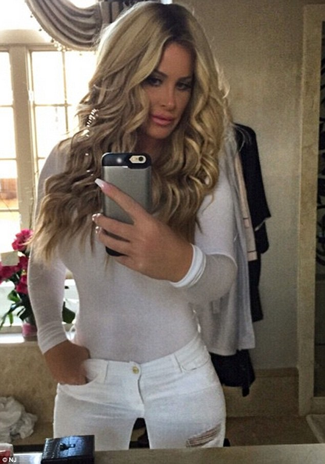 Selfie queen: The Don't Be Tardy beauty is happy to show off her figure but won't tolerate anyone criticizing the way her teen daughter looks