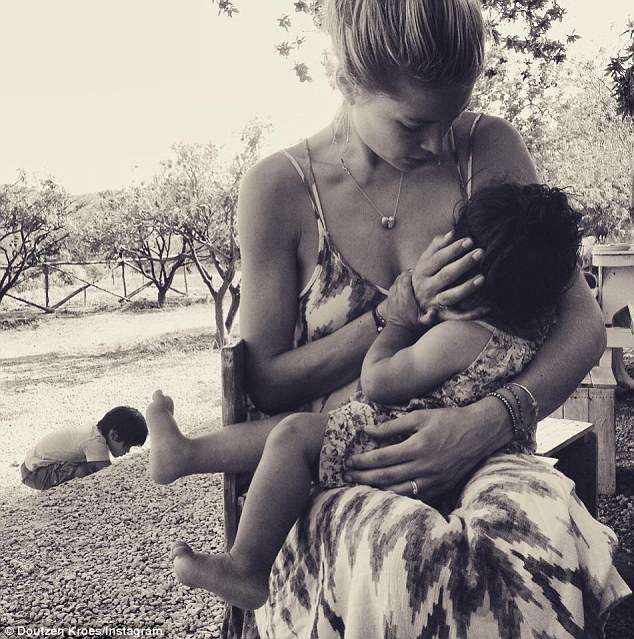 Model mommy: Doutzen Kroes shared this snap of her breastfeeding her daughterMyllena, one, on Tuesday