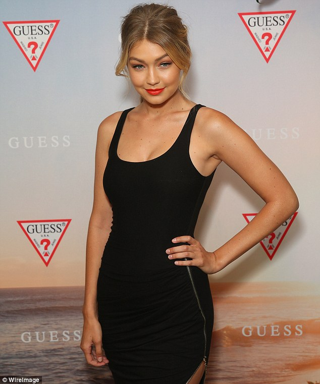 Looking good:The blonde model looked typically stunning in a fitted black dress as she made an entrance at lavish Potts Point restaurant The Butler