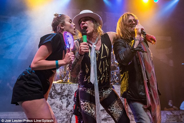 Singing goodbye:Miley Cyrus and her father Billy Ray helped Steel Panther send off the Hollywood House of Blues in style on Monday night (with Michael Starr centre)