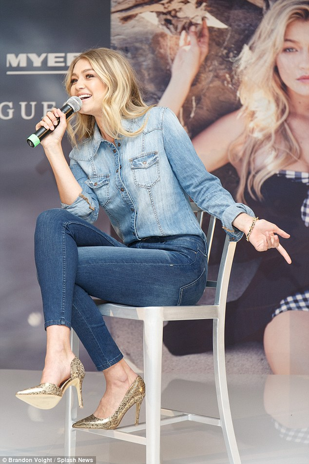 Elegance: She elegantly sat on a stool with her legs crossed while addressing the crowd