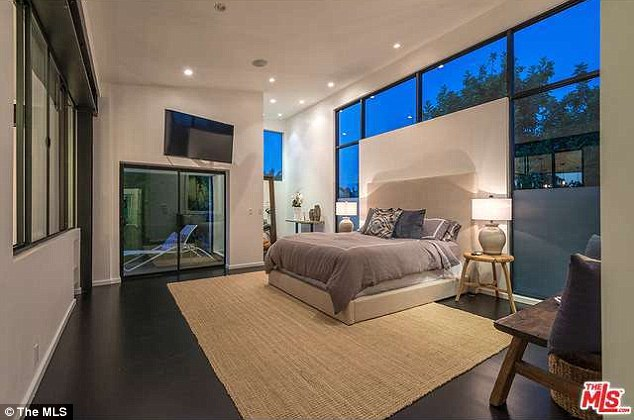 Peaceful retreat: After a long day on the court, Andy can get some much needed rest in the stunningly newly remodelled master bedroom which has floor to ceiling windows and its own balcony