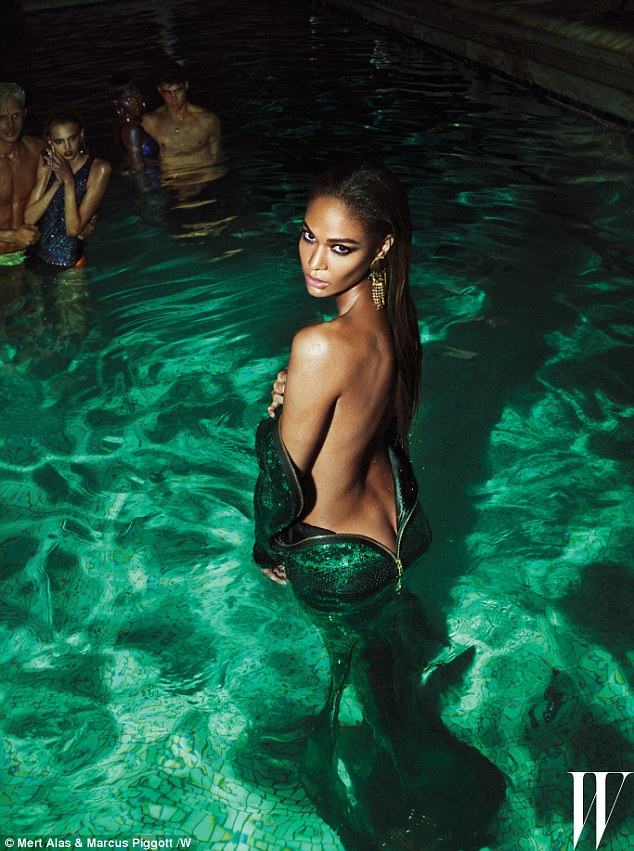 At one with the water: Model Joan Smalls merges with the swimming pool in an emerald green dress