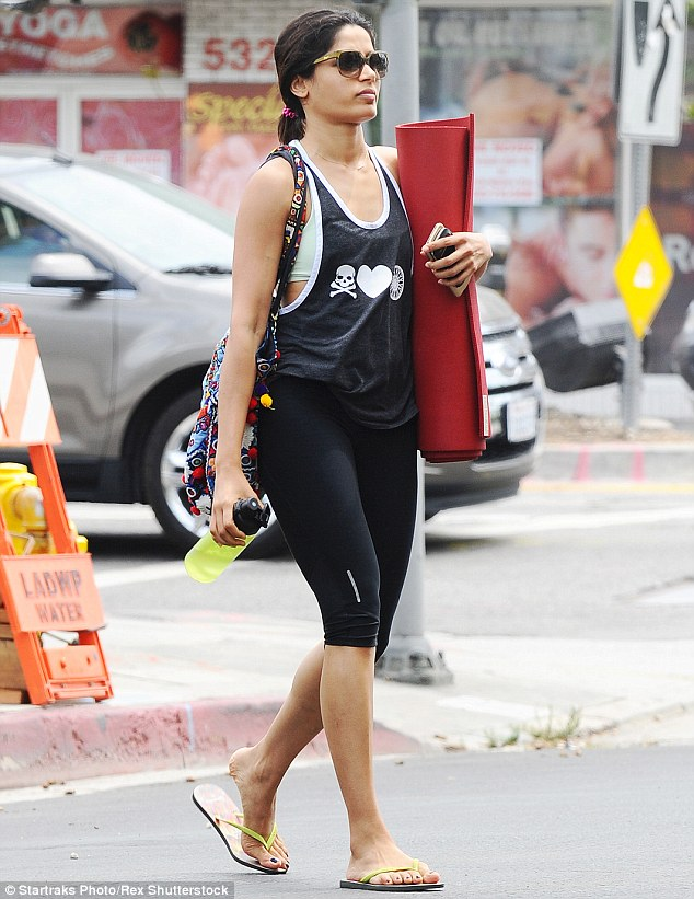 She means business! The Desert Dancer actress showed off her toned arms and slender frame in a powder green crop top which she layered with a grey racer back vest and knee-length leggings