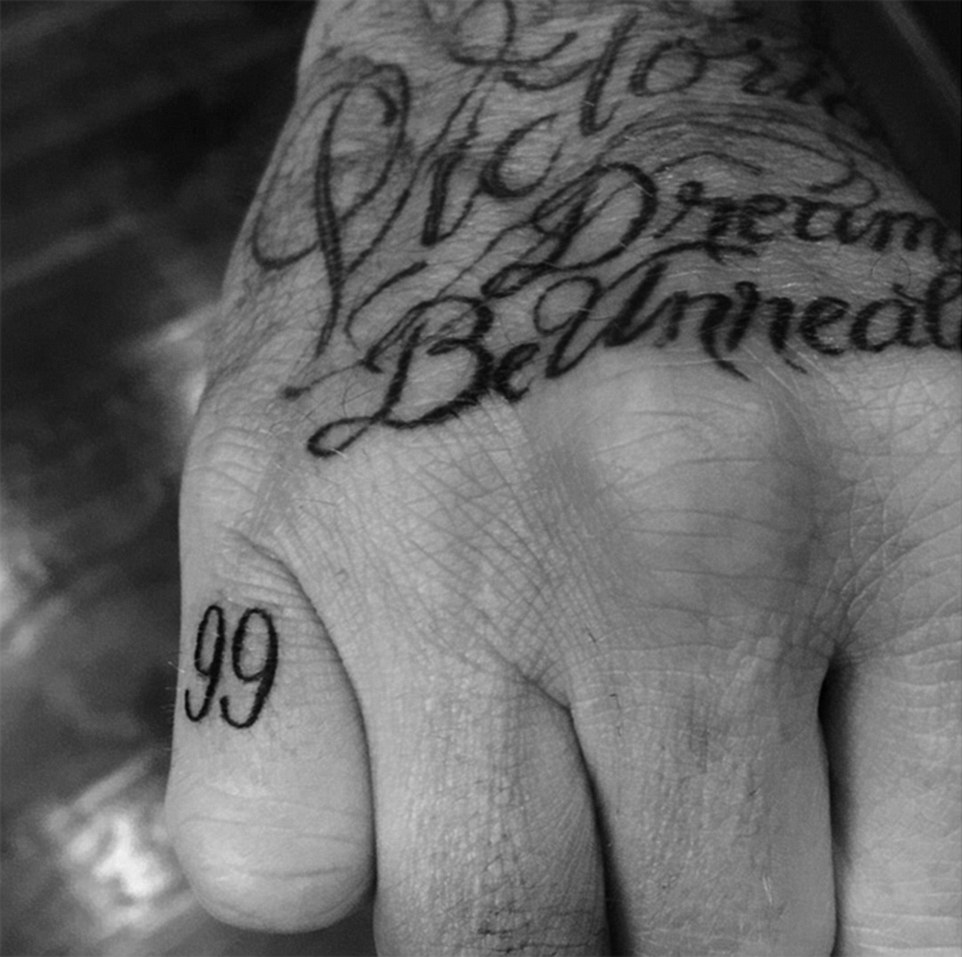 Just for you: Most recently, David got the number '99' tattooed on his little finger to mark the year he got married to wife Victoria