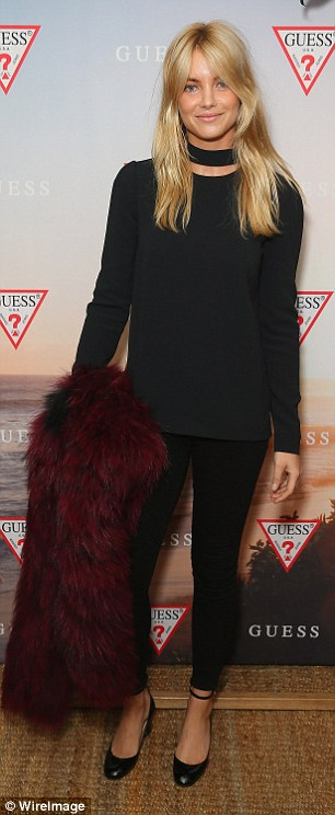 Hey, good looking! The 28-year-old beauty created a sleek silhouette in a pair of cigarette pants and a tailored long sleeved black top, which she teemed with a choker and a pair of round-toe heels