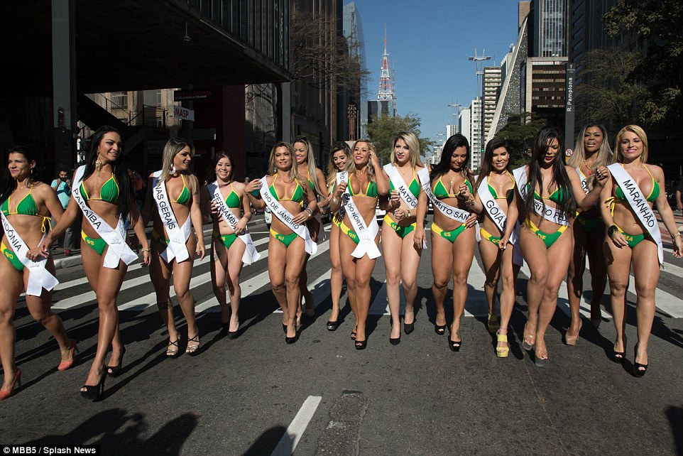Casual walk: Striding down the streets of Sao Paulo in their green and yellow bikinis and high heels, these cheeky models are busy promoting the much anticipated Miss Bum Brazil competition