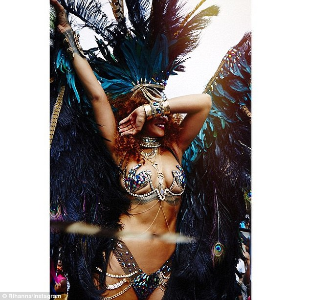 Camera shy: Rihanna hid her face as she shared an image of her extremely risque carnival outfit on the photo-sharing app