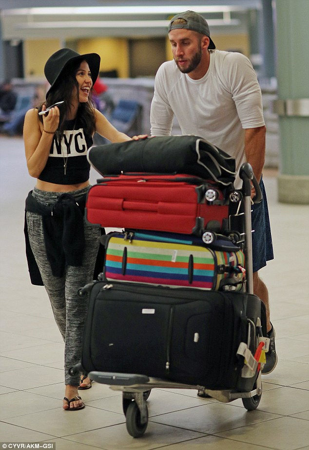 Fun personality: Bristowe flashed a smile and made a phone call after they finally collected their missing suitcase