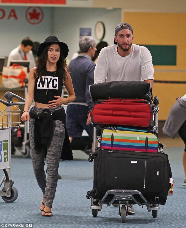Back home: Bachelorette Kaitlyn Bristowe and fiance Shawn Booth arrive in her hometown of Vancouver on Tuesday