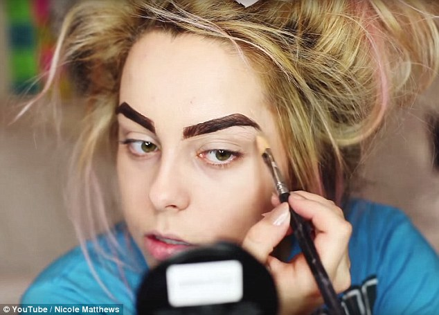 Optional step: Next, Nicole paints on thicker eyebrows - which she notes isn't necessary, but she personally likes to do her brows before applying concealer