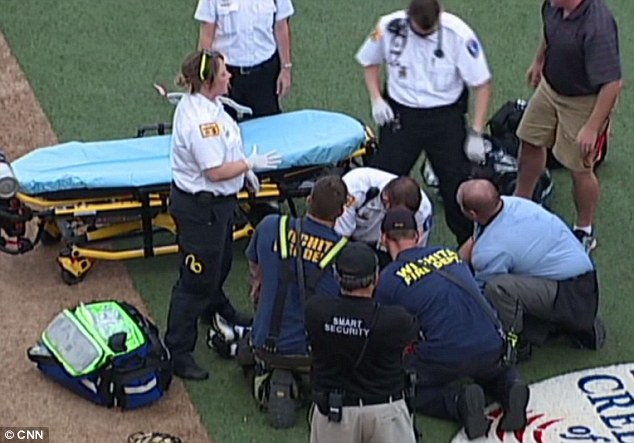 Treatment: An EMT crew - which was already at Lawrence-Dumont Stadium in Wichita for the National Baseball Congress World Series game - is pictured tending to Kaiser Carlile after he was fatally struck in the head by a practice swing