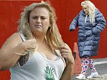 Mandatory Credit: Photo by Tania Coetzee/REX Shutterstock (4928777b)\n Rebel Wilson\n 'Grimsby' on set filming, Cape Town, South Africa - 04 Aug 2015\n Mark Strong, Isla Fisher and Cohen were also on set. Wilson flew into the city on her own a few days ago after rumours that she will tie the knot with new boyfriend, Mickey Gooch in Las Vegas later this year.\n