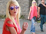 Tara Reid looking healthy except for the cigarette she's smoking with a friend after lunch in Beverly Hills. August 3, 2015. X17online.com