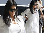 140875, EXCLUSIVE: Kim Kardashian looks ready to pop as she jets out of New Orleans wearing a skin tight white dress. Kim made her way through the Louis Armstrong International Airport with friends and a bodyguard with her baby bump on full display. She arrived in the city on Monday night to celebrate a fans 21st birthday in town. New Orleans, Louisiana - Tuesday August 4, 2015. Photograph: © PacificCoastNews. Los Angeles Office: +1 310.822.0419 sales@pacificcoastnews.com FEE MUST BE AGREED PRIOR TO USAGE