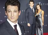 """Miles Teller, left, and Keleigh Sperry attend the premiere of """"Fantastic Four"""" at the Williamsburg Cinemas on Tuesday, Aug. 4, 2015, in the Brooklyn borough of New York. (Photo by Charles Sykes/Invision/AP)"""