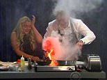 """5 August 2015 - Los Angeles - USA  **** STRICTLY NOT AVAILABLE FOR USA ***  Gordon Ramsay almost sets CBS studios on fire during cooking segment with James Corden on The Late Late Show. Corden had challenged the Brit chef and his 13 year-old daughter Matilda to a cook-off to see who could create the best full English breakfast. But Ramsay kicked off a whole bunch of chaos as he decided to put his bacon directly on the electric hob to make it crispy. Instead huge clouds of smoke billowed from the hob, obscuring Ramsay and Matilda as Corden looked on stunned. Then when Ramsay put the pan back on the hob, flames shot out, leavingt Ramsay turning the  the air blue and had to have swear words bleeped six times as he patted the fire out with his apron. As the audience clapped, Corden told the chef: """"Iíve got to be honest, youíre clapping but that is not what a real chef would do,"""" before adding: """"You're a joke!"""" Despite their mishap, the Ramsays were the first to finish their full English a"""
