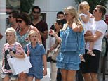 EXCLUSIVE: Steven was spotted early in the afternoon at the Grove with wife Alex and daughters Lilly-Ella, Lexie and Lourdes. He was also joined by a couple of friends and Alex's mum. The group first stopped for lunch at La Piazza where they spent about an hour eating. After that the girls wanted to look at the water fountain and they then walked through the grove stopping at various shops. The whole family looked incredibly happy with Steven stopping a few times to take photos with fans who recognized him. Steven stopped to pick up his youngest daughter and planted a kiss on her all of the daughters looked happy to be spending quality time with their dad. After spending almost an hour walking around the group went to the grab their cars at the valet before driving off  Pictured: Steven and Alex Gerrard  Ref: SPL1091559  030815   EXCLUSIVE Picture by: Splash News  Splash News and Pictures Los Angeles: 310-821-2666 New York: 212-619-2666
