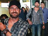 The Scot flashed a smile as he arrived in Sao Paulo, reportedly to tape an advert for Ford. The trip appears to be a perfect marriage of business and pleasure - Butler is a fan of the tropical country and in previous visits has often been caught by photographers flirting with local beauties. \n\nPictured: Gerard Butler\nRef: SPL1094670  040815  \nPicture by: Photo Rio News / Splash News\n\nSplash News and Pictures\nLos Angeles: 310-821-2666\nNew York: 212-619-2666\nLondon: 870-934-2666\nphotodesk@splashnews.com\n