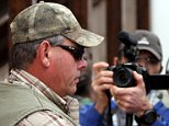 Zimbabwean hunter Theo Bronkhorst talks to media outside the Hwange magistrates court, August 5, 2015.  A Zimbabwean court on Wednesday postponed his trial for failing to stop American dentist Walter Palmer illegally killing the country's most prized lion last month. Bronkhorst was arrested last week and charged with breaching hunting rules when he helped Palmer lure Cecil, a rare black-maned lion, out of Hwange National Park and shoot him with a bow and arrow, in a case that caused international outrage online and put the spotlight on big game hunting in Africa. REUTERS/Philimon Bulawayo