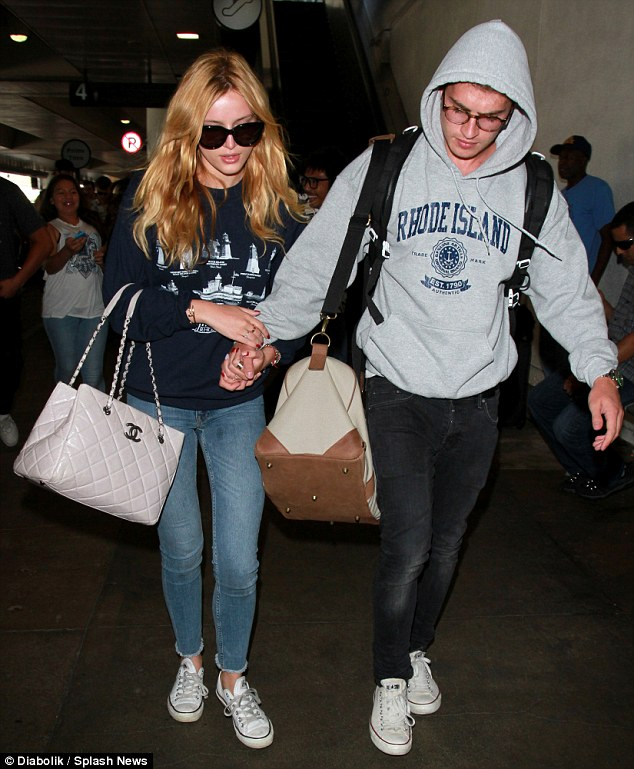 Laid-back: Gregg matched Bella's casual style, as he also sported a Rhode Island sweatshirt with a coordinating pair of white, low-top sneakers