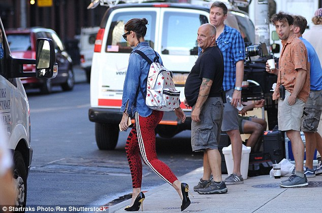 All eyes on her! The brunette beauty was not to be missed as she crossed the street