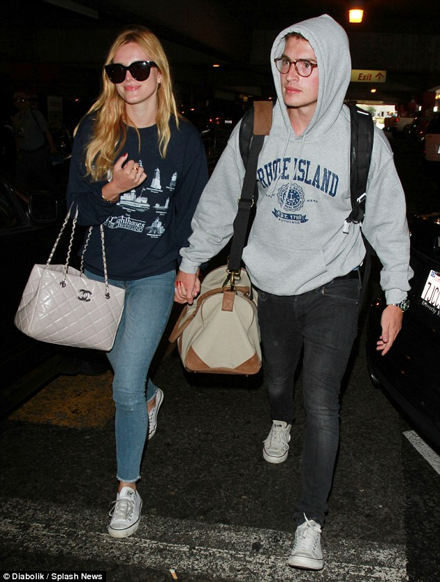 Low-key: Bella Thorne looked casual as she was spotted at LAX airport on Tuesday walking hand-in-hand with boyfriend Gregg Sulkin