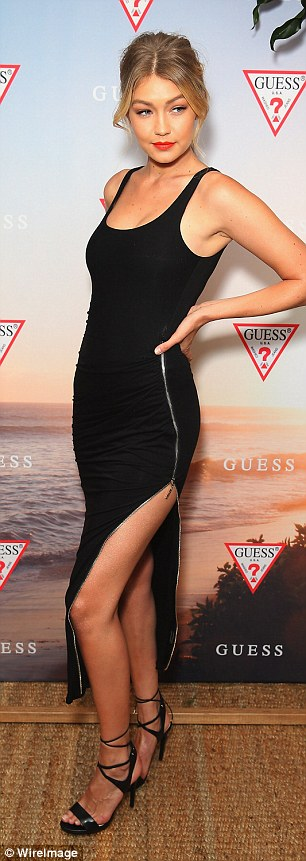 The thigh's the limit: Gigi launched the GuessSpring 2015 Collection at The Butler in Potts Point on Tuesday evening wearing this black dress slit to the thigh