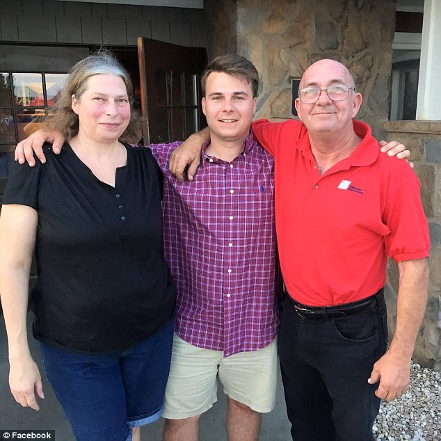Tragic end: The 23-year-old, pictured with his parents, was discovered floating naked in ankle-deep water