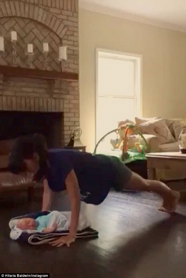 'Rafa becomes my trainer': The brunette beauty also shared a video of herself performing push-ups over her resting son earlier in July